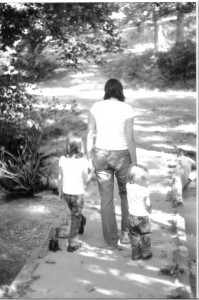 My sister-in-law walking with her two daughters. Her daughters cling to her hands and trust she is leading them down the correct path.